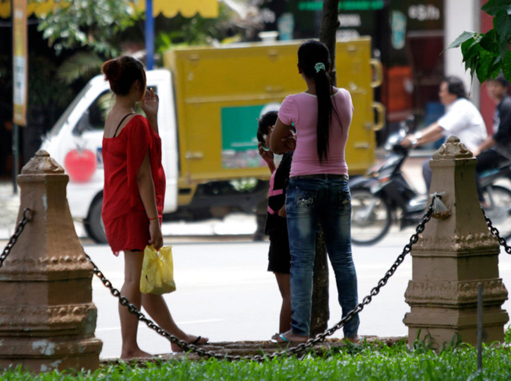 Cambodian sex workers waiting for customers at a public park in Phnom Penh.Credit Chor Sokunthea/Reuters