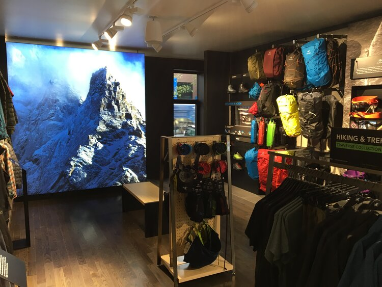 Arc'Teryx feature wall mural and merchandise displays