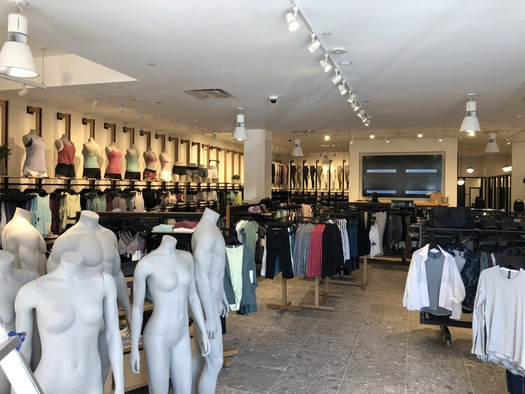 lululemon athletica interior with merchandise and mannequines