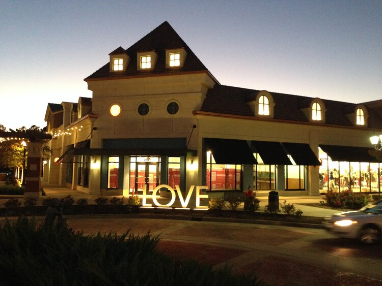 lululemon athletica exterior love sign at night
