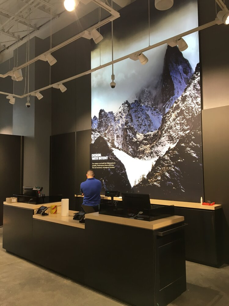 Arc'Teryx service desk and mural of mountains
