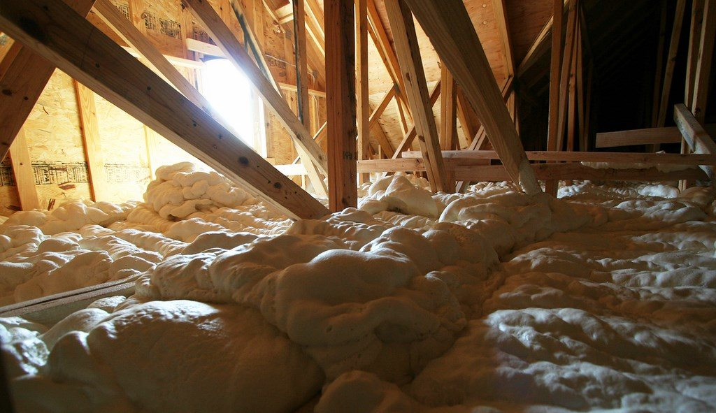 Foam Engineers Spray Foam Insulation on Attic Floor of Home in St Louis (Town & Country).