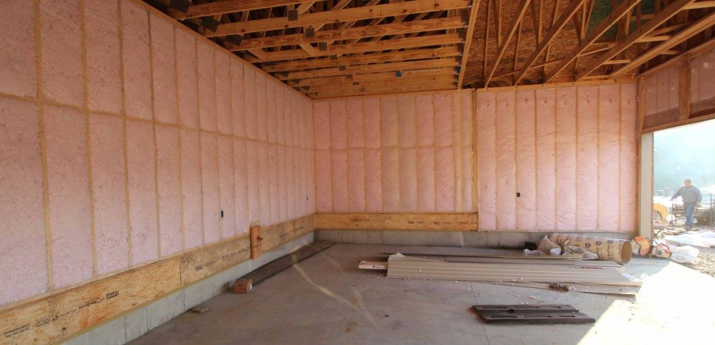 Dense Pack Fiberglass Insulation in Walls Between Garage and House (common walls).