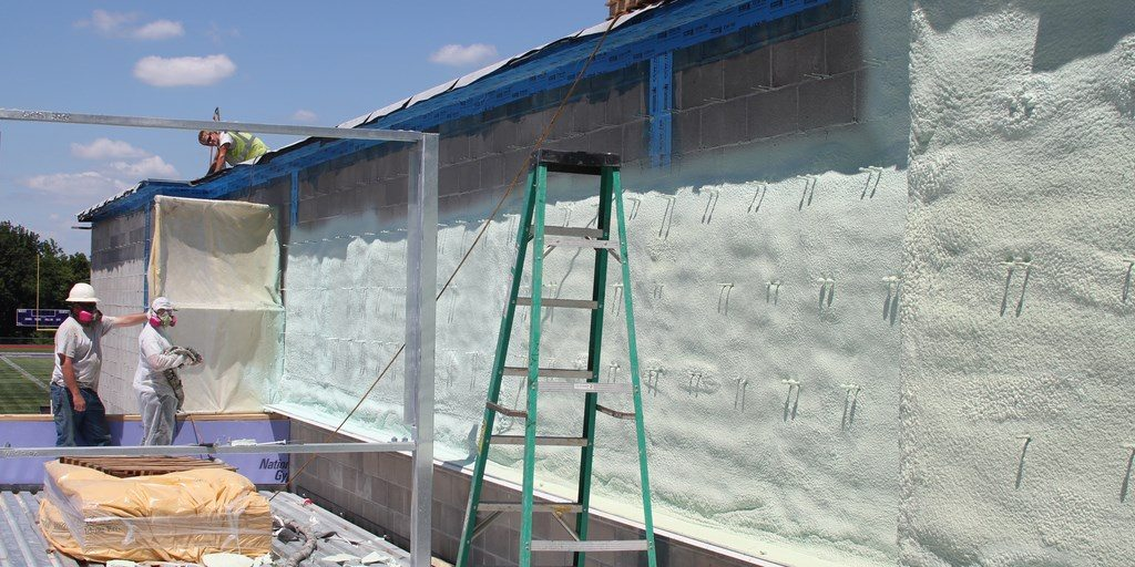 Self adhered and spray foam air barriers in one wall assembly.