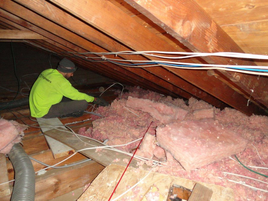 Foam Engineers Removes Old Fiberglass Insulation From Attic