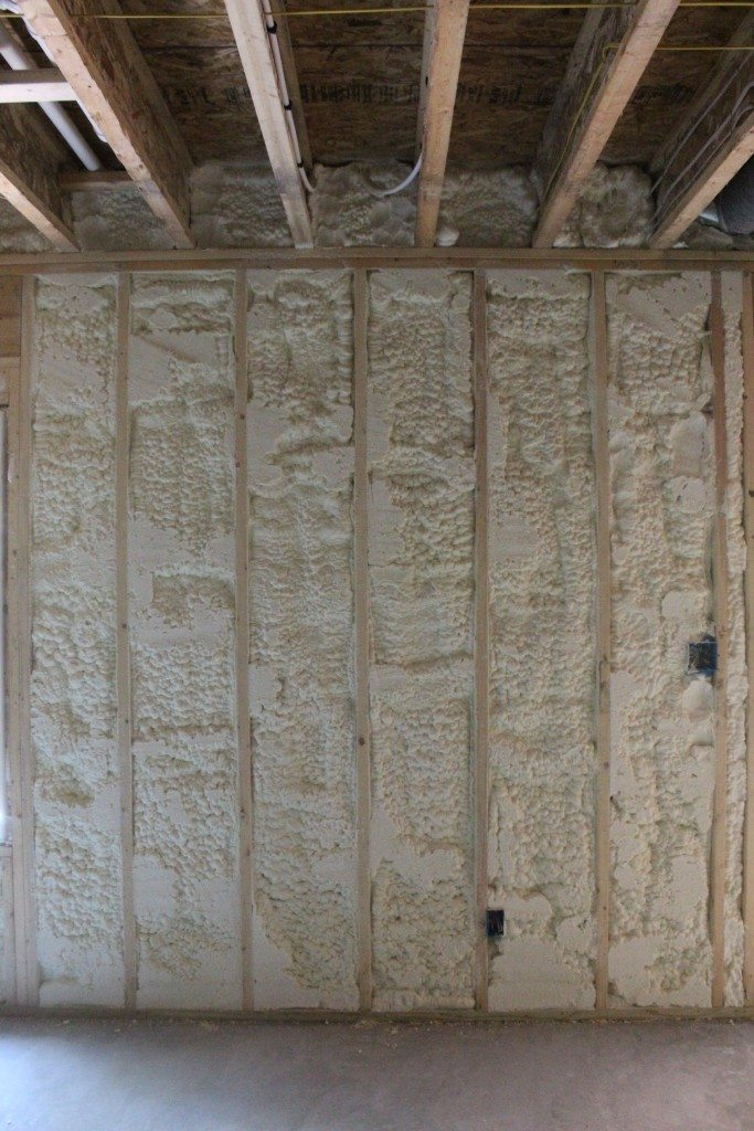 Above grade basement walls and the rim boards around the top of the entire basement were sprayed with open cell spray foam.