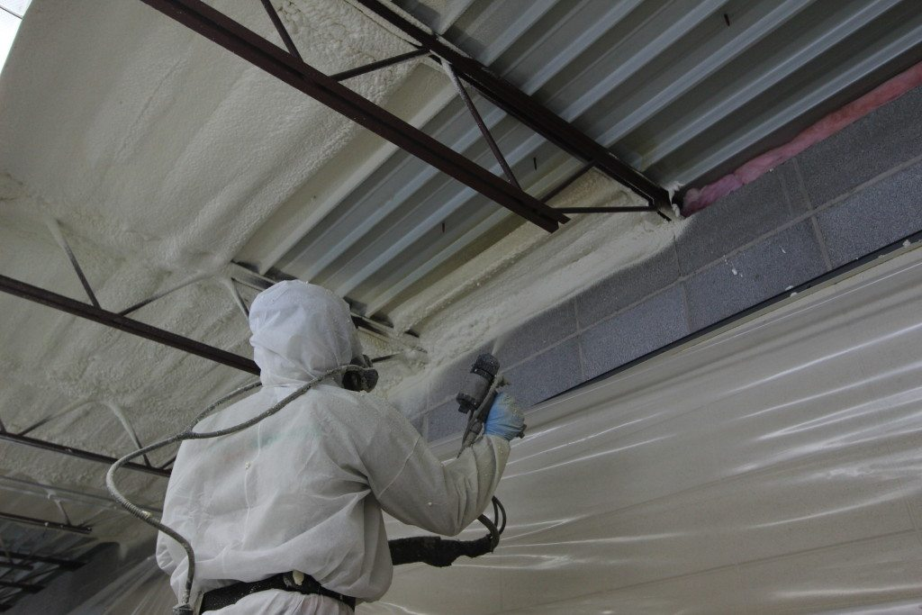 Fiberglass batts were used to block the gap between the block wall and the roof. Foam Engineers then applied closed cell spray foam  to the underside of the metal roof structure. This application created an air seal and insulated from the wall to the roof.
