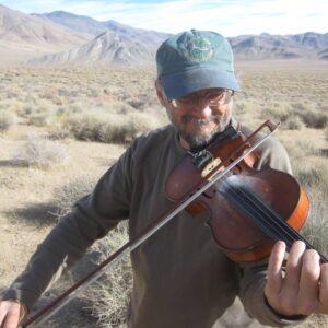 Phil fiddling in the desert
