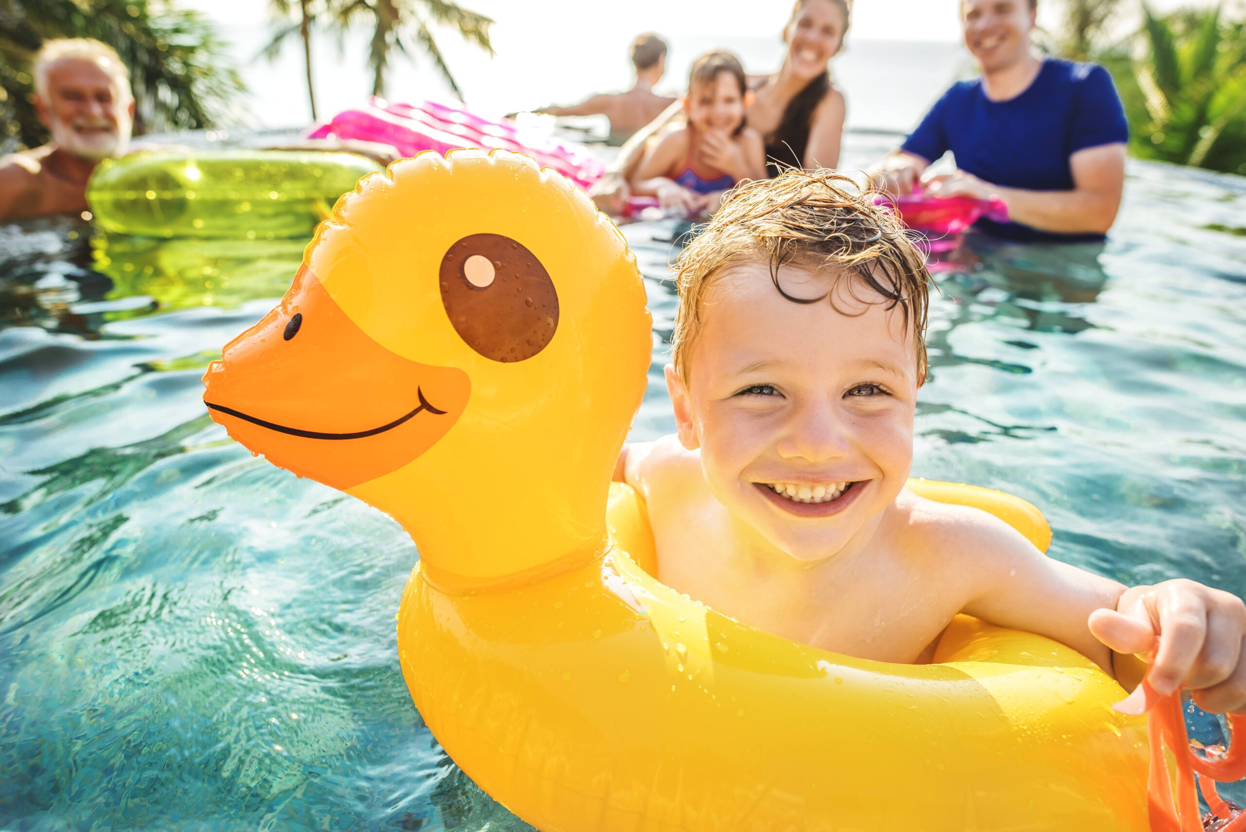 Young Boy Swimming in a pool during summertime.