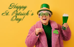 woman in leprechaun hat wishing you a happy St. Patrick's Day!