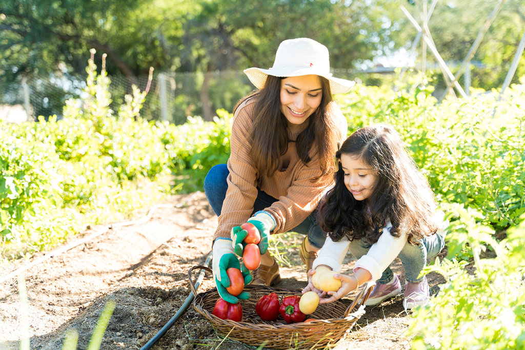 Image of mother and daughter gardening