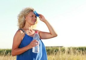 Mature woman with water bottle in summer