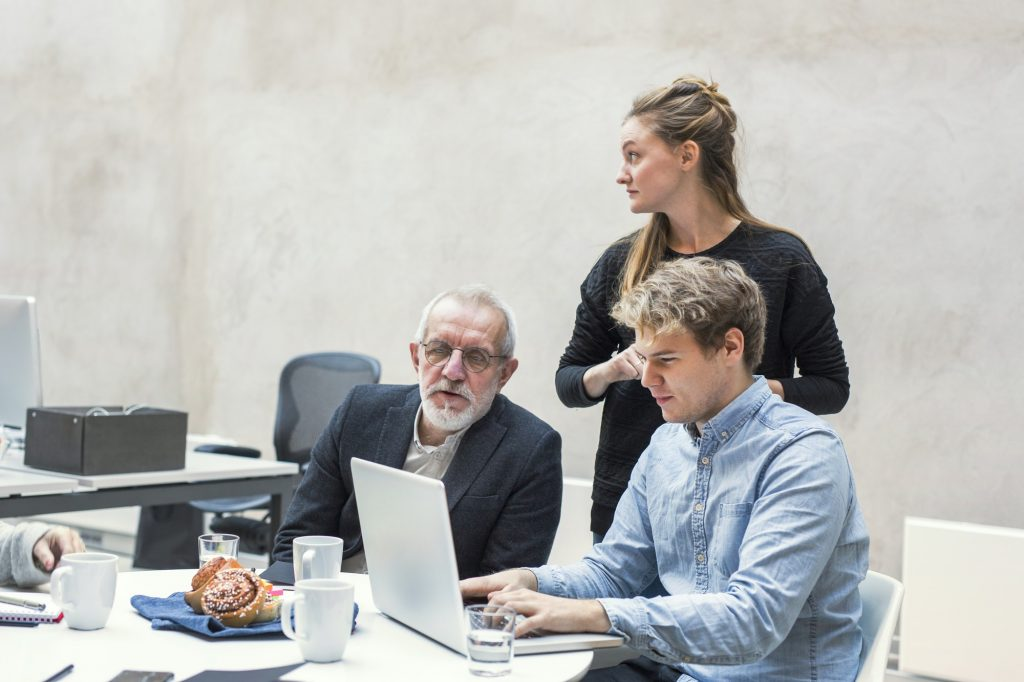 Business people preparing project on laptop in office