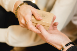image of two hands holding a gift card
