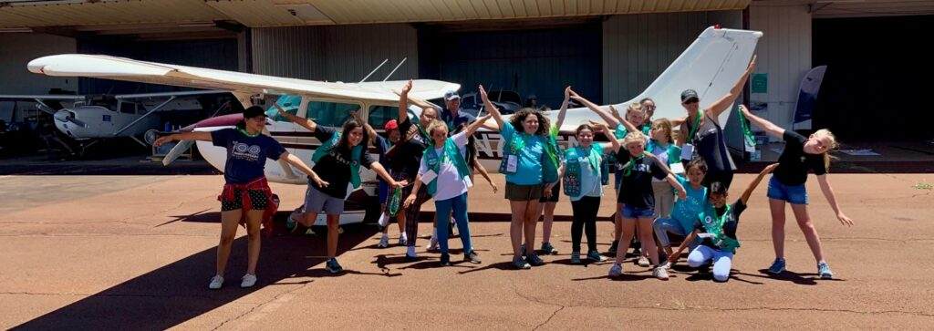 Girlscouts with plane