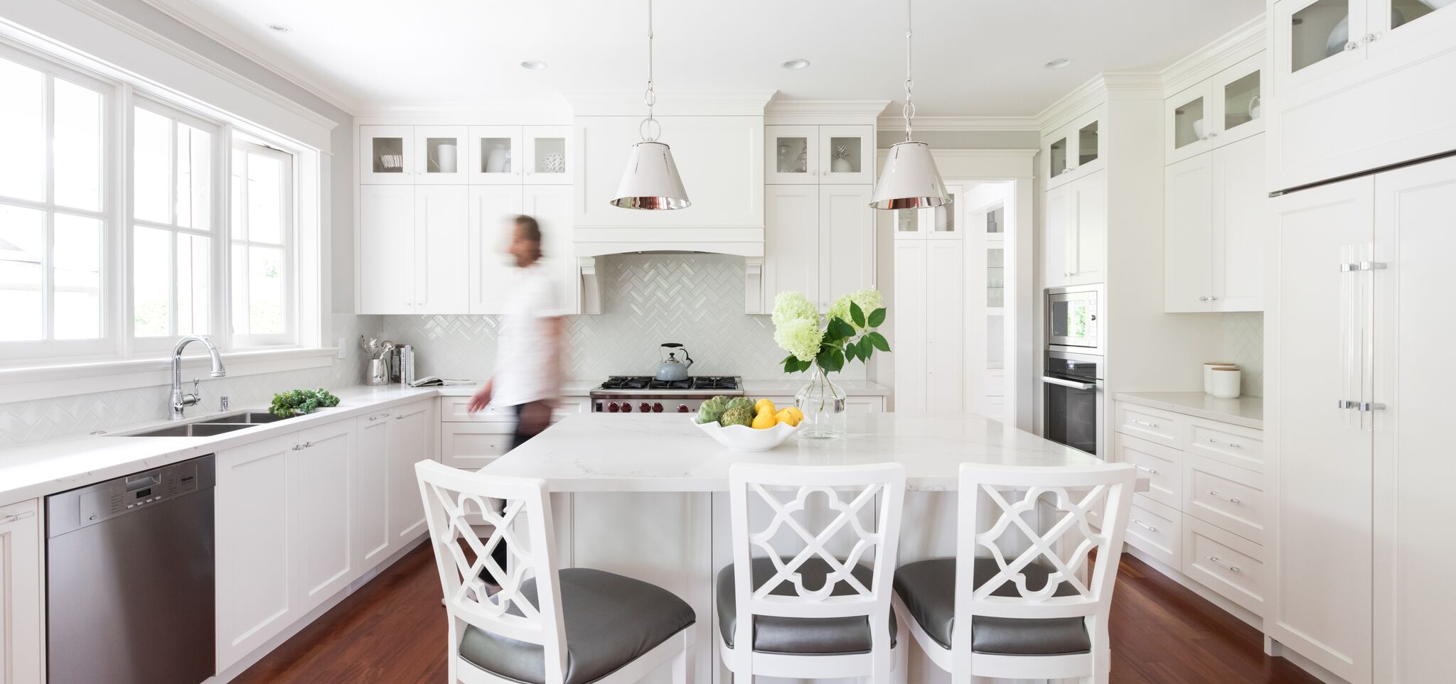 All white kitchen with a center aisle