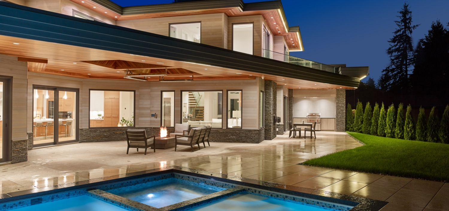 Outdoor living room with a fire pit, grill, and a swimming pool