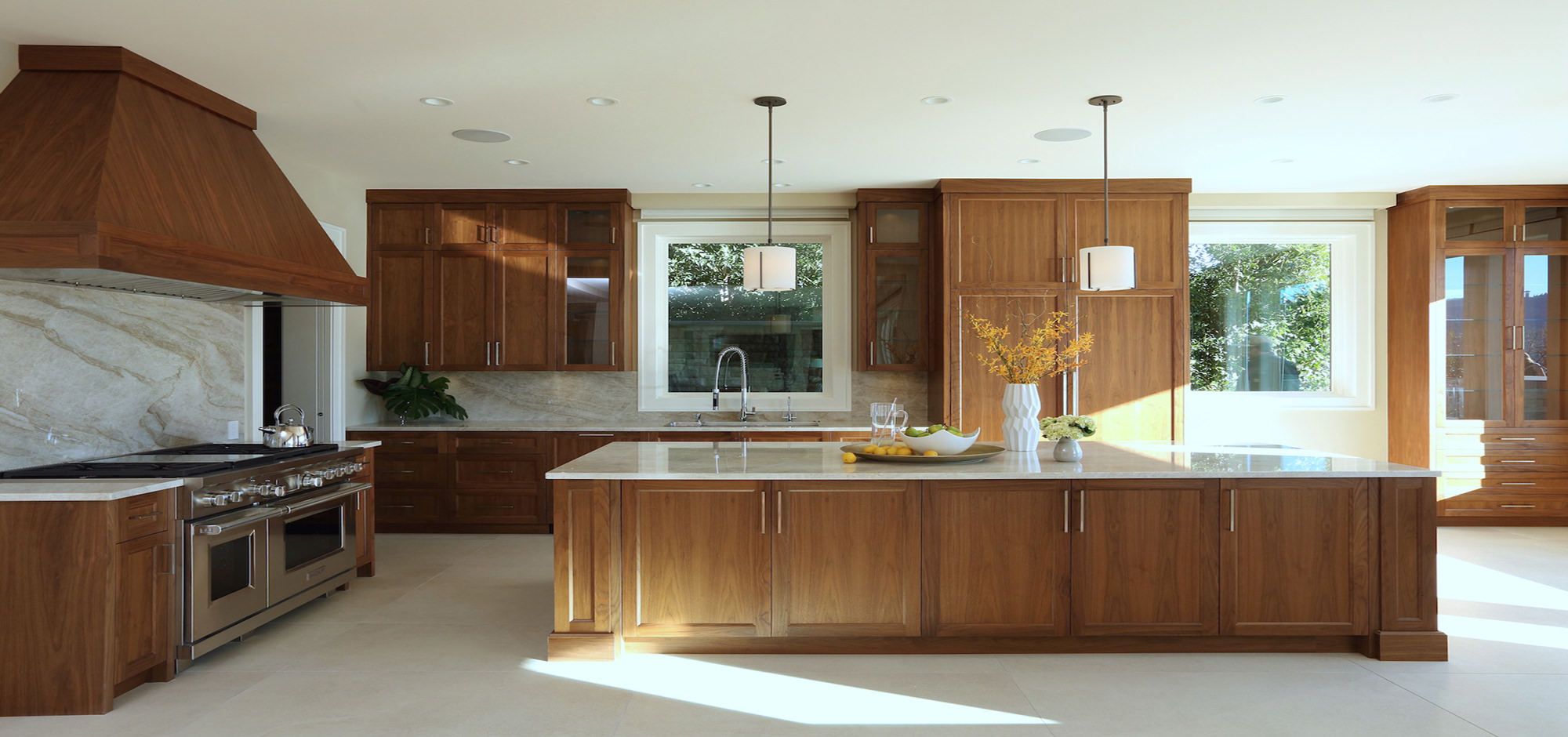 Modern kitchen with wood-designed cabinetry and white marble countertops