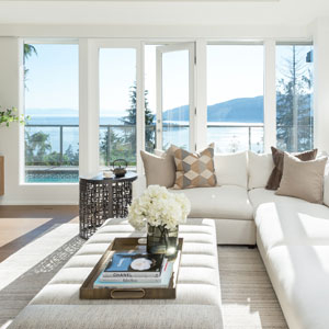 White couch in a living room with full-wall windows