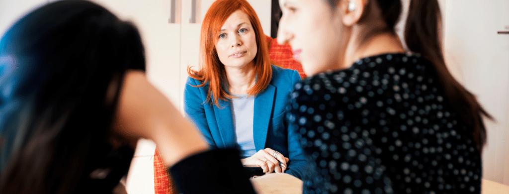Three business women in conversation
