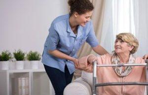 caregiver helping an elderly woman
