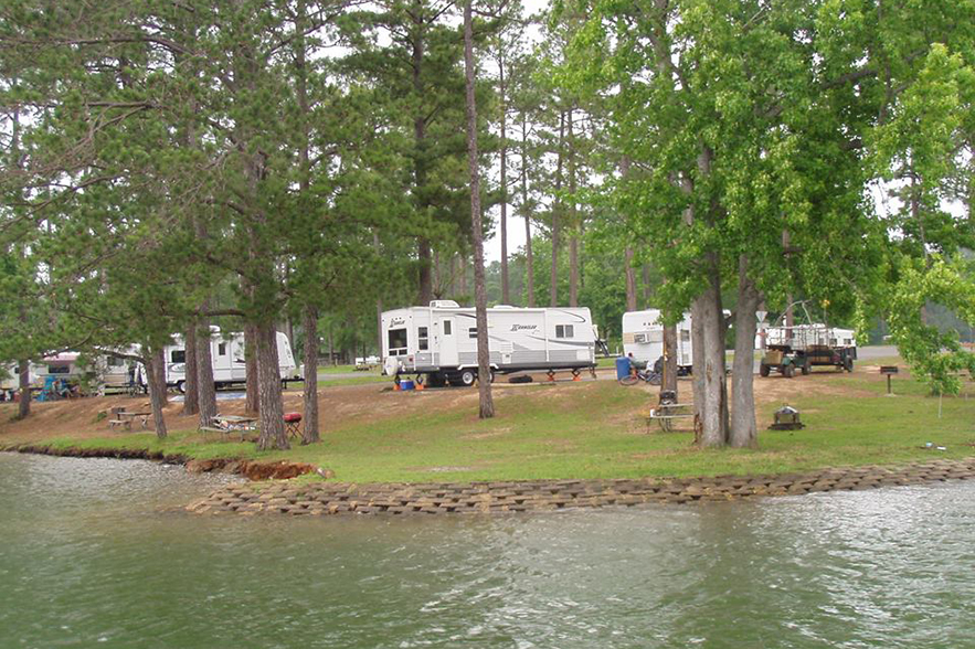 RV campers by water