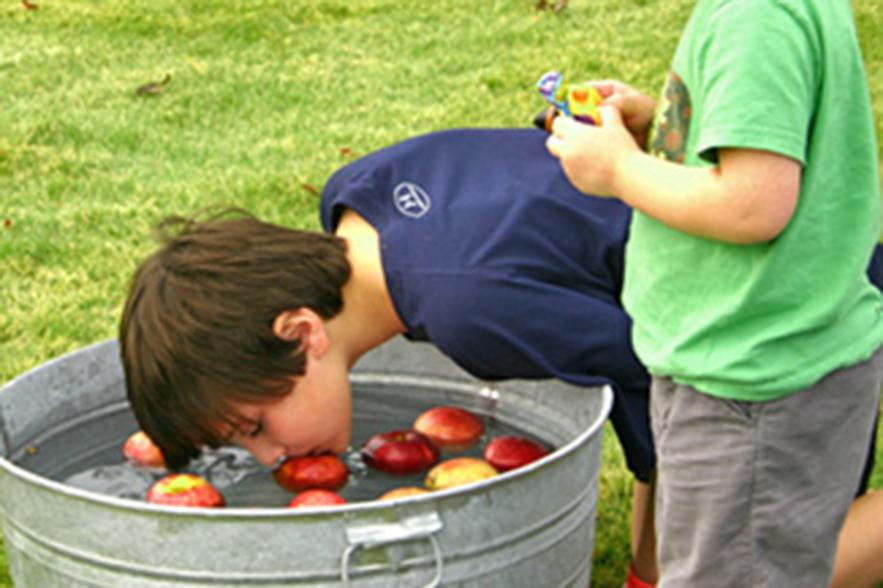 kid bobbing apples