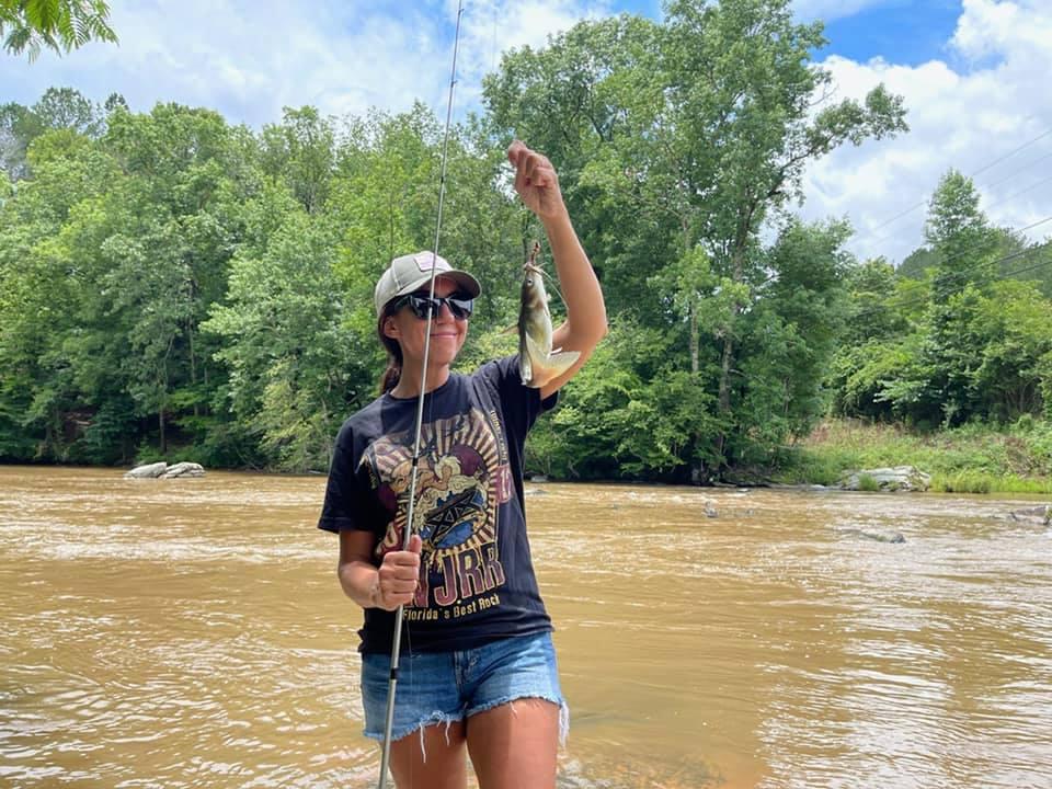 girl holding catfish