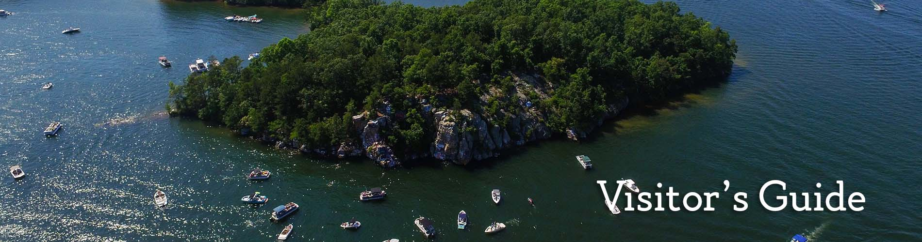 Aerial view of island surrounded by boats