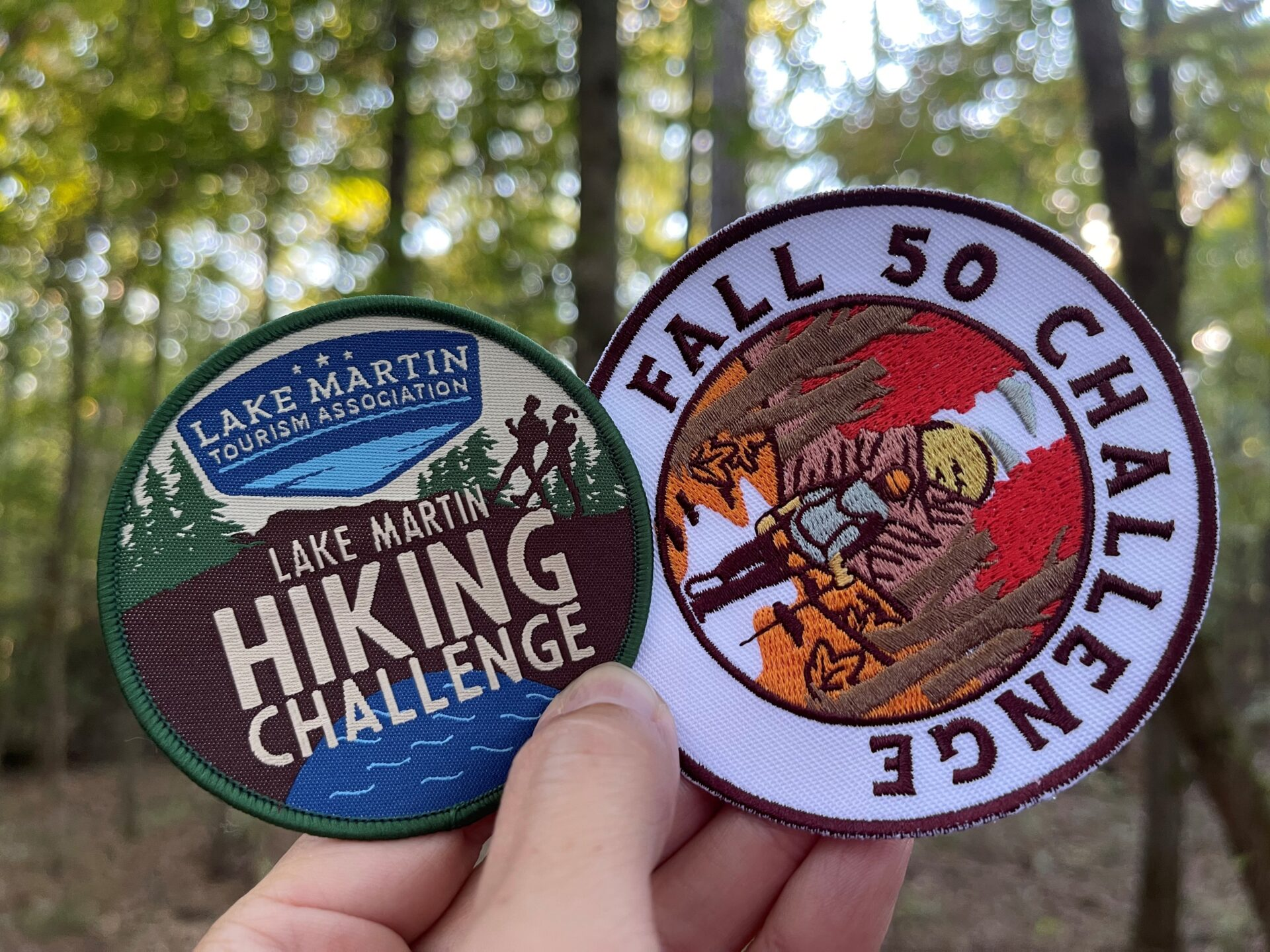 two hiking challenge patches