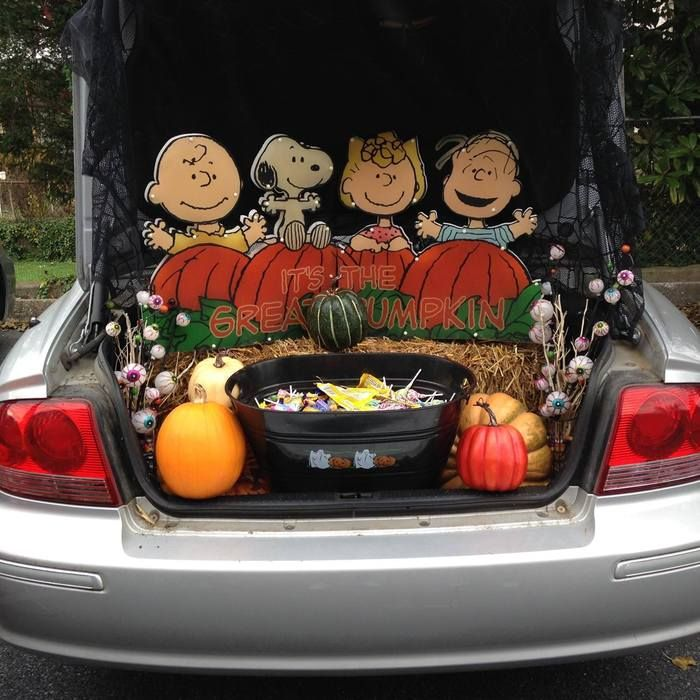 trunk of car with halloween candy in back