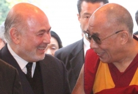 Granoff with His Holiness the Dalai Lama, with whom he served on a panel at a Nobel Laureate Summit in 2011.