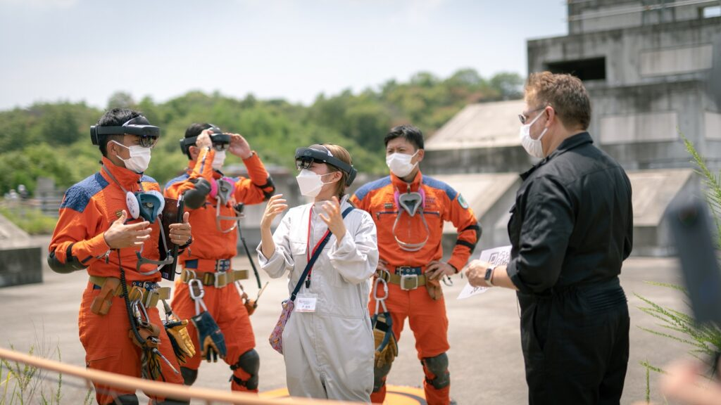 Firefighters and staff members discussing the pilot operation.