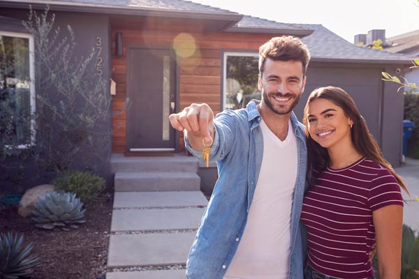young couple buying home in Colorado