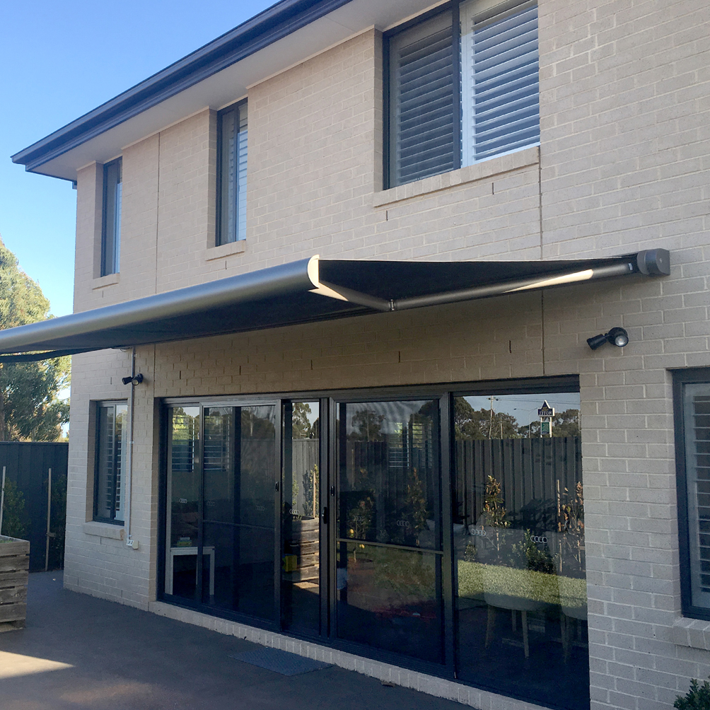A picture of a house with external awnings
