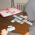 A student arranges words in columns according to the visual patterns of words containing the Long I sound.sttern