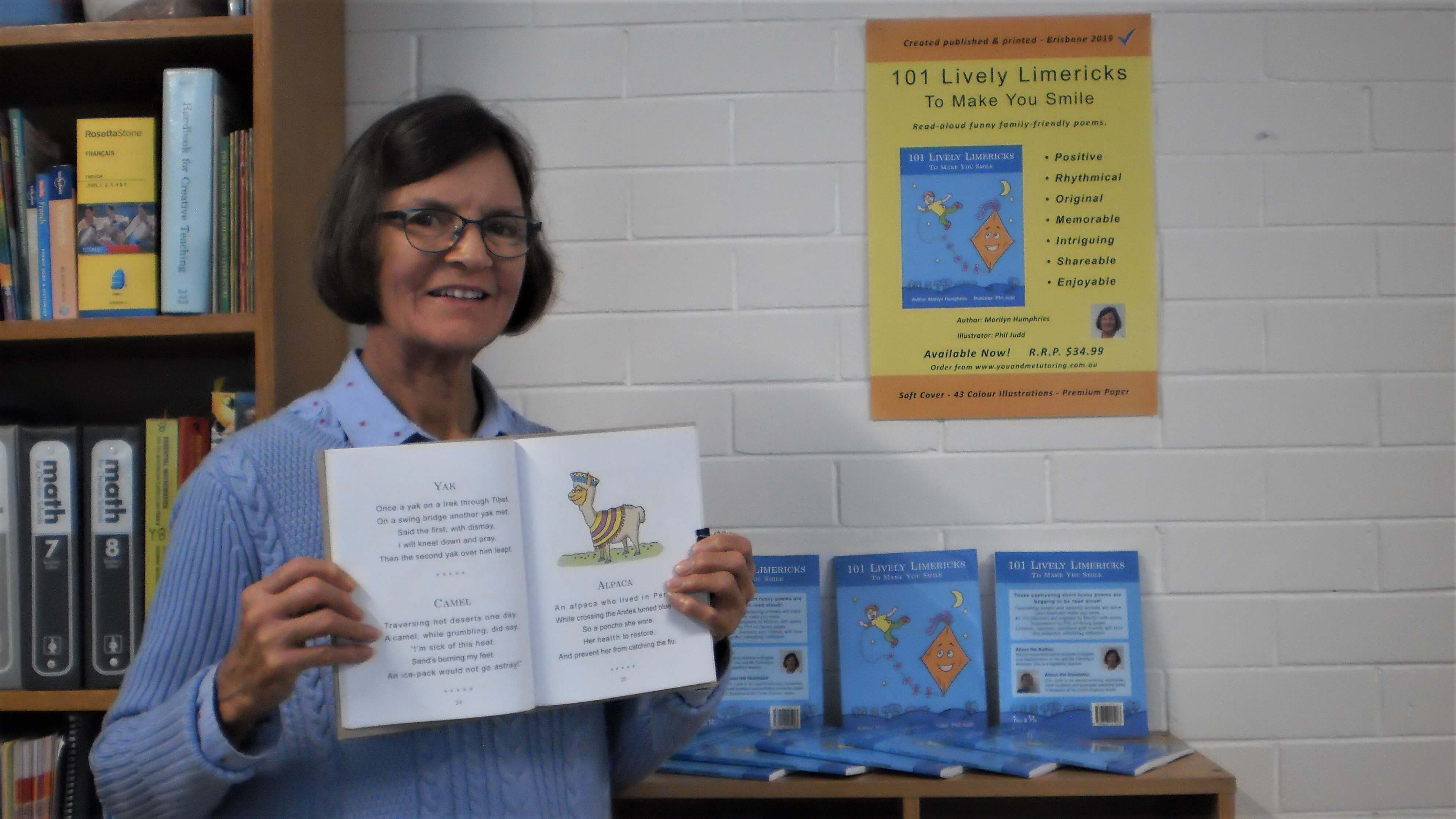 Marilyn shows her book of funny poems for children and adults.
