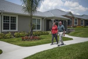 Senior Couple Walking the 48-acre Neighborhood Community