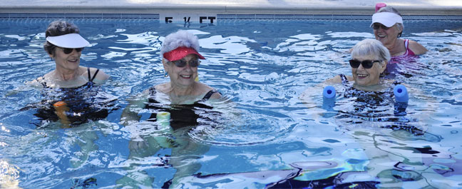 Active Seniors Swimming and Relaxing in the Pool