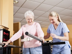 Physical therapist with senior woman, gait training