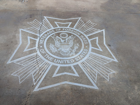 Logo etched into concrete