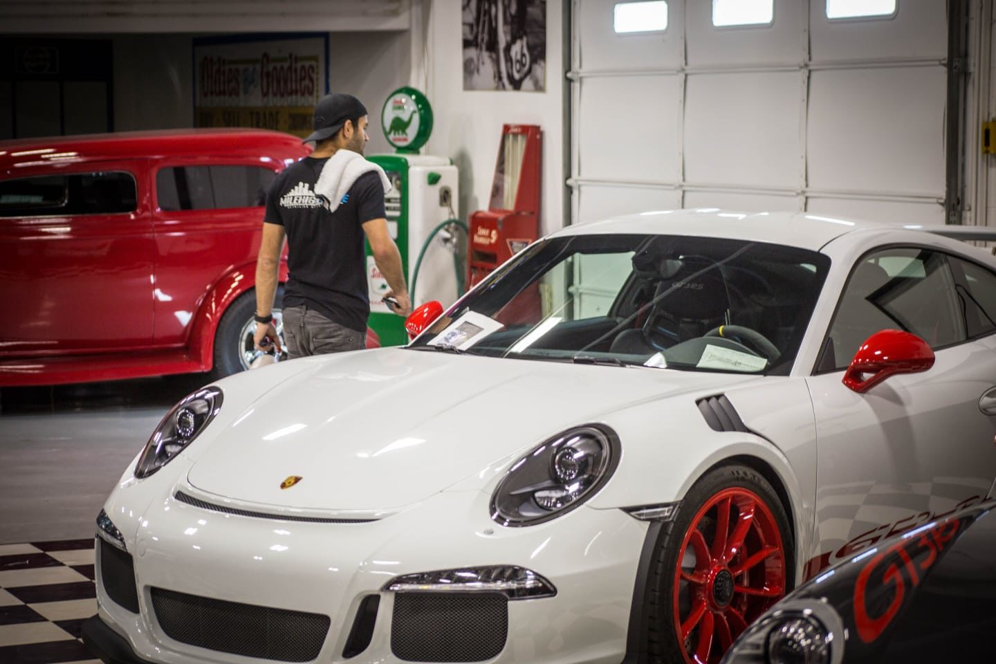 A white sports car after a ceramic coating and car detailing in the shop