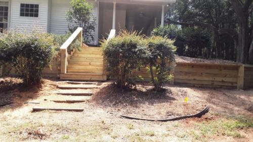 Stairs with custom retaining wall