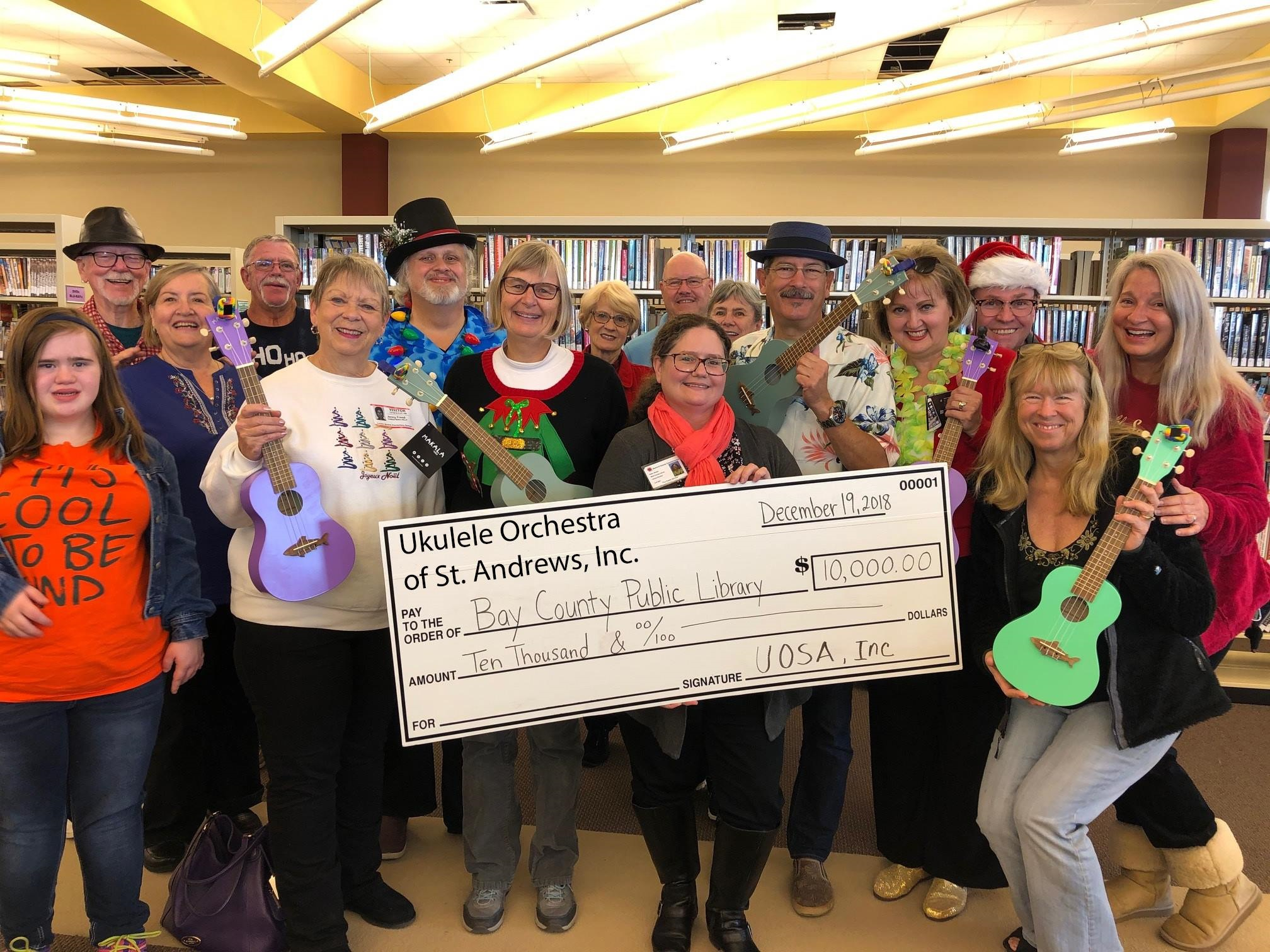 Ukulele Orchestra Check to the Library