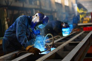 Welders at work in manufacturing
