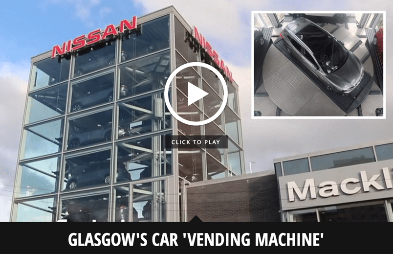 Bizarre glass tower stacked full of cars