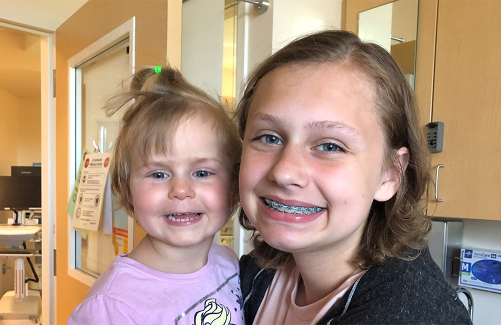 female teen and female toddler in photo