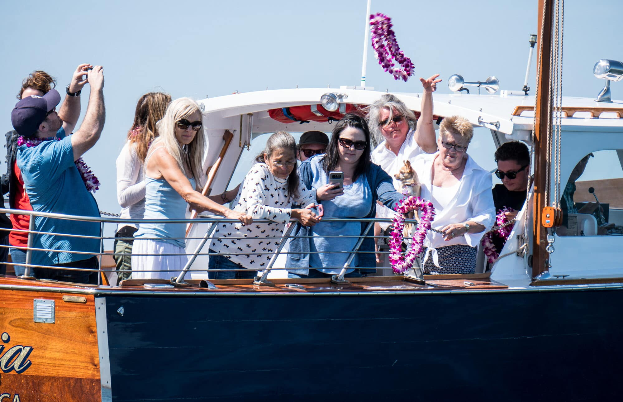 family, burial at sea, lei, traditional ash scattering,