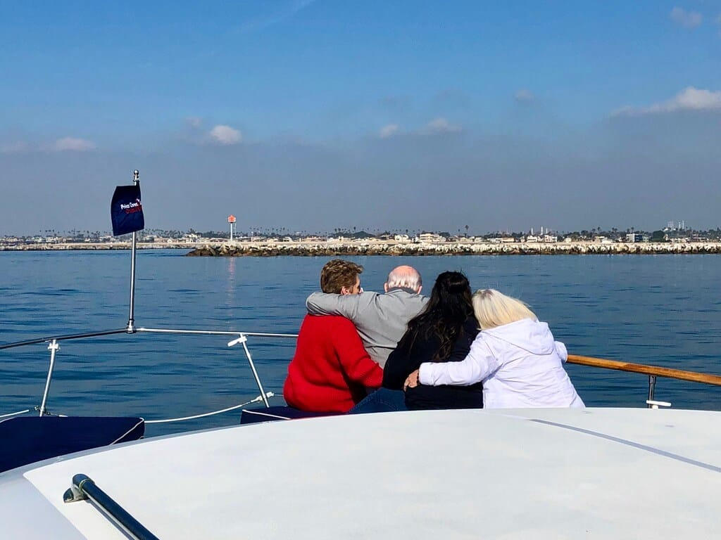 Family together during a funeral on luxury yacht in Huntington Harbour
