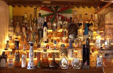 Image of bar with bottles of alcohol backlit